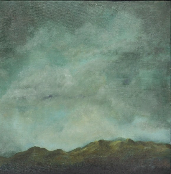 irish oil landscape of hills in rossmore west cork, very darky stormy sky dark green headland